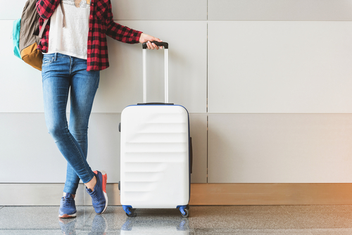 lady traveling with her luggage